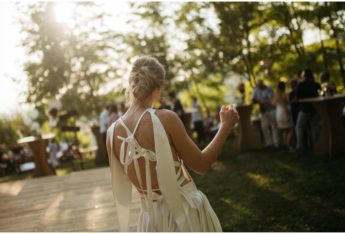 bride dancing on a backyard wedding