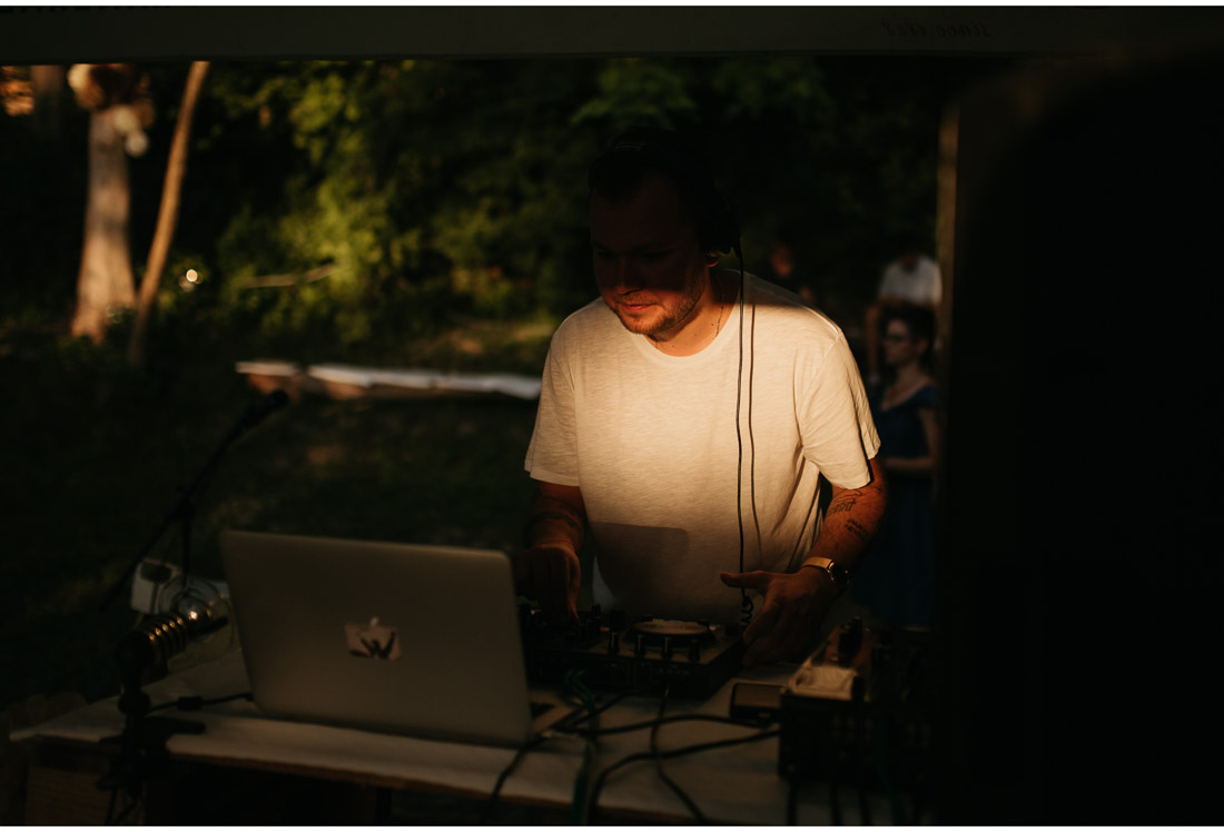dj at a backyard wedding party