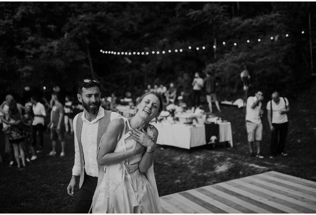 happy bride and groom first dance at a backyard wedding party