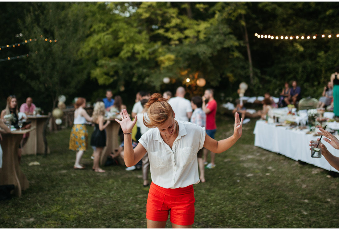 happy guest dancing at a backyard wedding party
