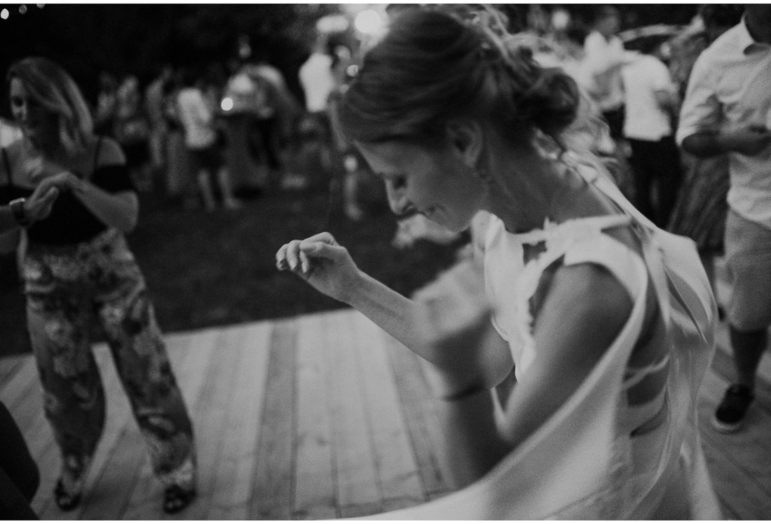 bride dancing at a backyard wedding party