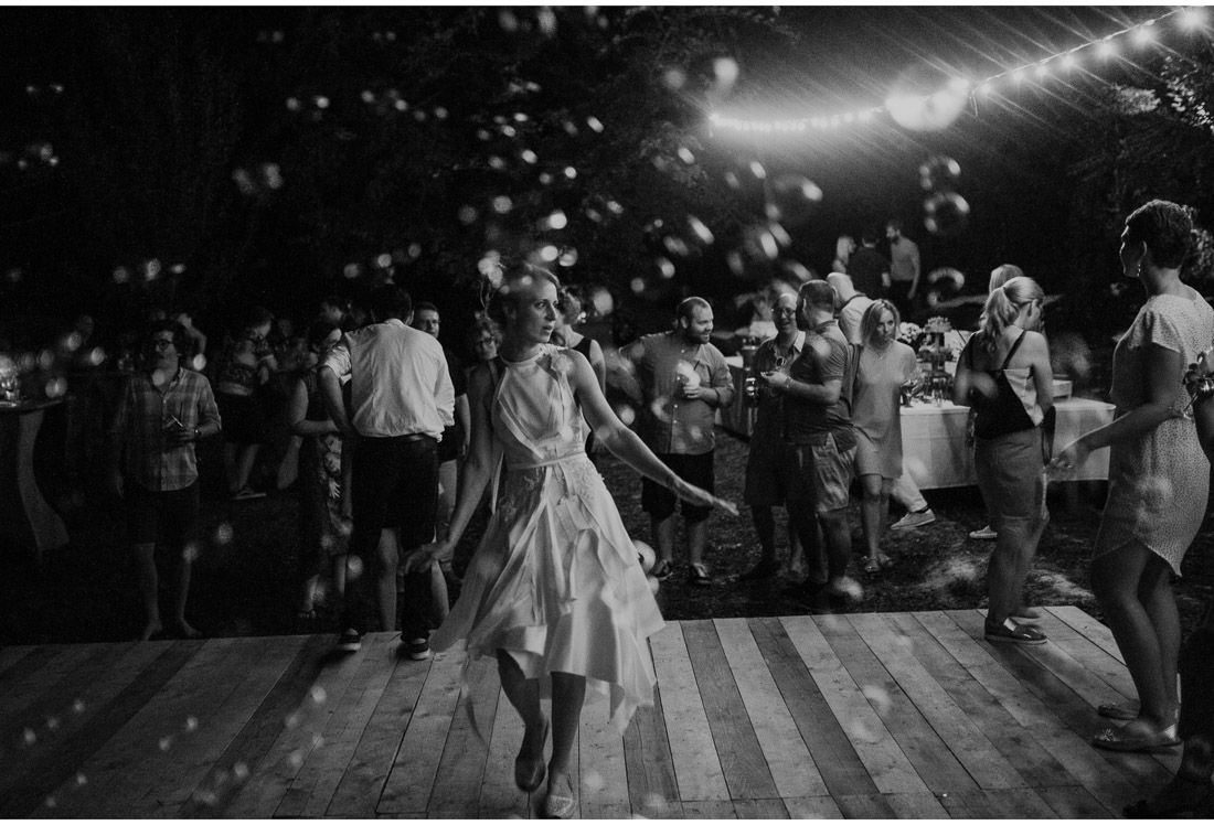 backyard wedding party bride dancing