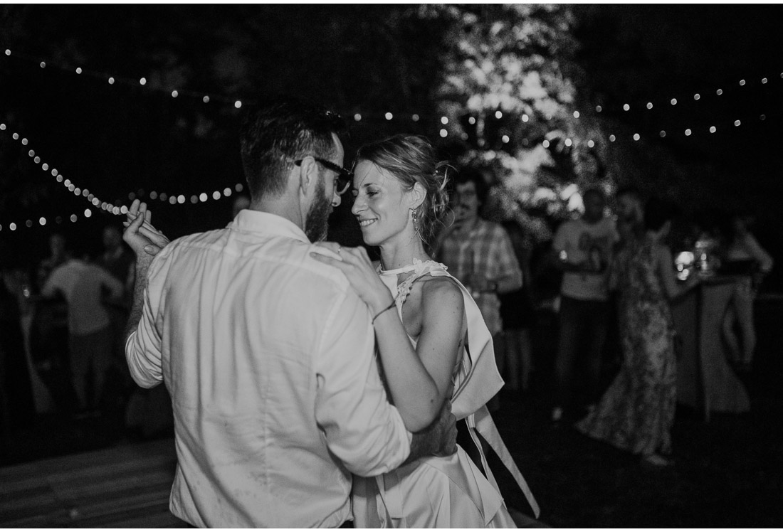 bride and groom dance at a backyard wedding party