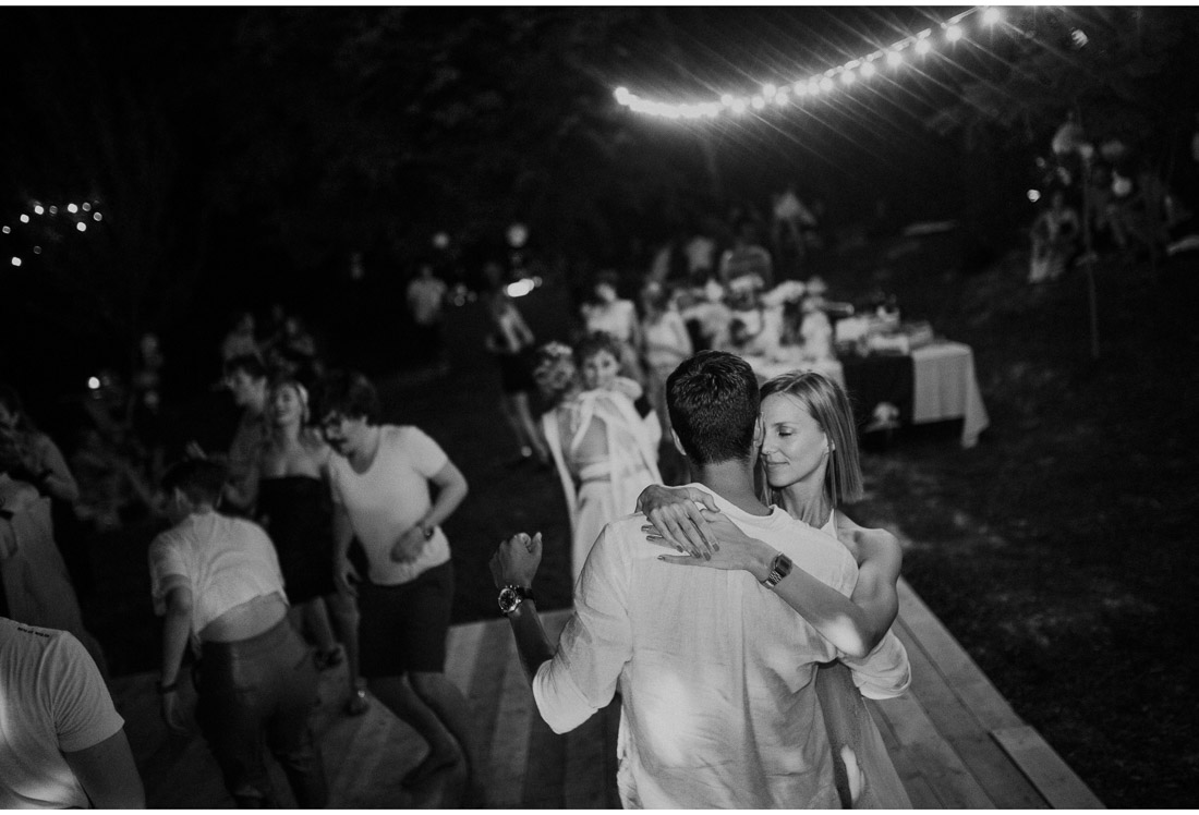 young couple dancing at a backyard wedding party