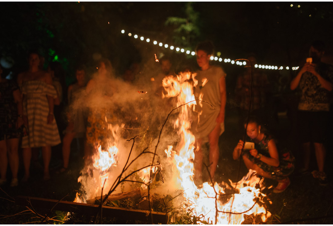 bonfire at a backyard wedding party