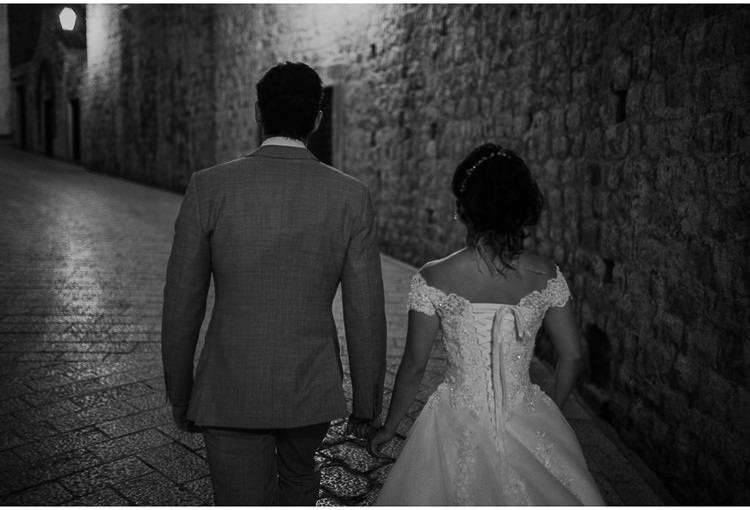 bride and groom walk in dubrovnik