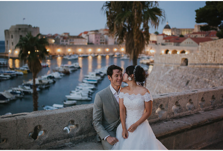 bride kiss groom at dubrovnik city walls