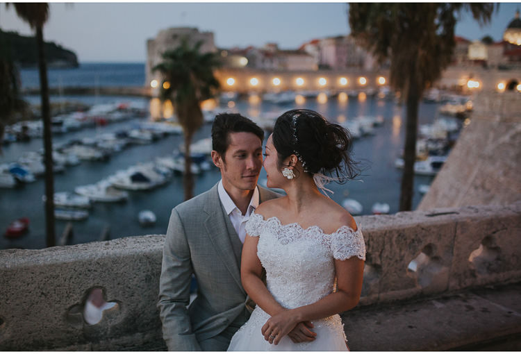 bride and groom at dubrovnik city walls