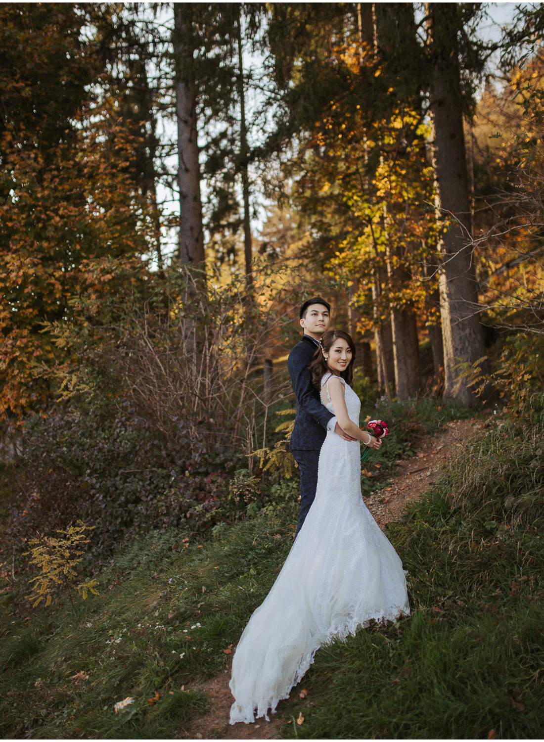 bride and groom pose in the forest near Lake Bled