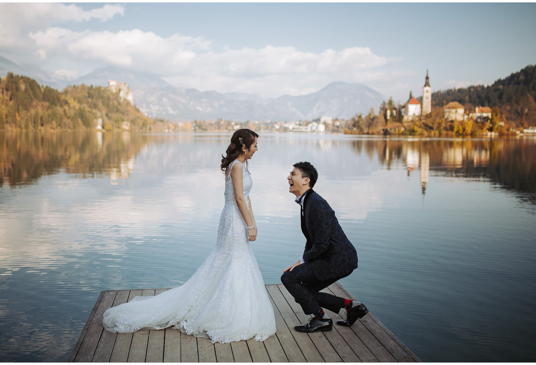 groom proposing to bride on Lake Bled wedding shoot